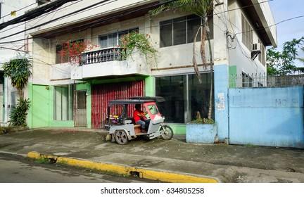 Kalibo, Philippines - Dec 16, 2015. Trickshaw parking on street in Kalibo, Philippines.