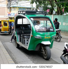 Kalibo, Philippines - Dec 17, 2015. Tuk tuk on street in Boracay island, Philippines. Boracay Island and its beaches have received awards from numerous travel publications and agencies.