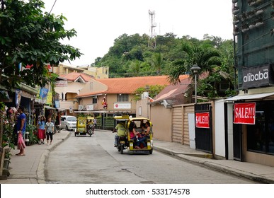 Kalibo, Philippines - Dec 17, 2015. Tuk tuk running on street in Boracay island, Philippines. Boracay Island has received awards from numerous travel publications and agencies.