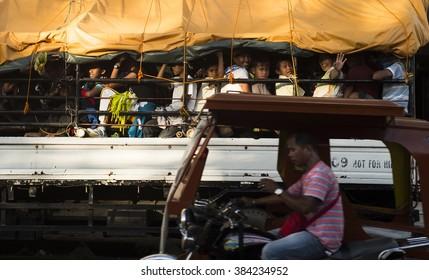 Kalibo, Philippines - February 13, 2016. Filipino people in a trucks box