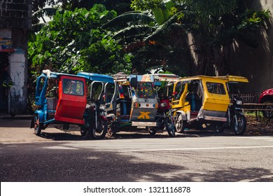 Kalibo, Philippines - January 13, 2016: motor tricycles parked on the side of a road waiting for customers in Kalibo, Philippines.
