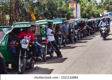 Kalibo, Philippines - January 13, 2016: motor tricycles lined up waiting for customers in a road in Kalibo, Philippines.