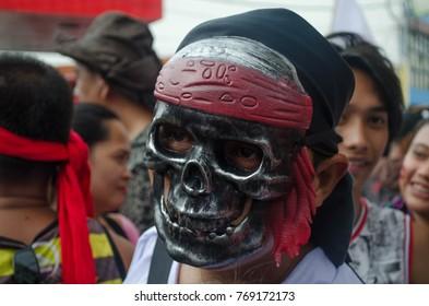 Kalibo, Philippines - January 14 2017: Ati-Atihan festival, a man wearing a skull mask