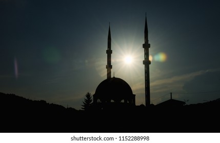 Kalibunarska džamija (mosque) located in Travnik, Bosnia and Herzegovina. Sunset time when the sun is located right between two minarets of the mosque.