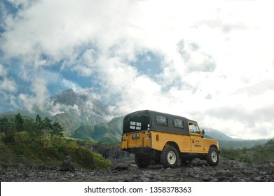 Kalikuning, Yogyakarta, Indonesia. Sept, 12 - 2017. a classic landrover series III with Merapi volcano at the background