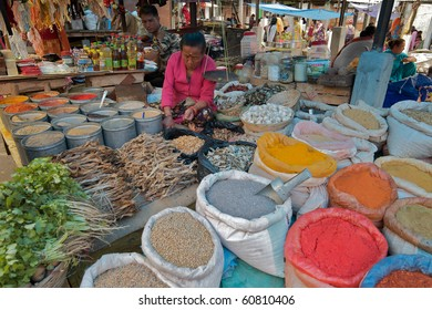 KALIMPONG, INDIA - MAY 19: market-woman sits amidst her goods on May 19, 2010 in Kalimpong, West-Bengal, India