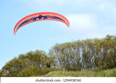 KALININGRAD REGION, RUSSIA - AUGUST 18, 2018: A paraplane wing in the sky over Curonian Spit