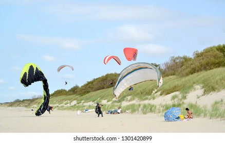 KALININGRAD REGION, RUSSIA - AUGUST 18, 2018: Flights of paraplanes over Curonian Spit