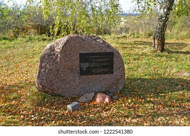 KALININGRAD REGION, RUSSIA - OCTOBER 21, 2018: A memorable stone on the place of burial of the victims of a march of death near Konigsberg 1945, a Holocaust