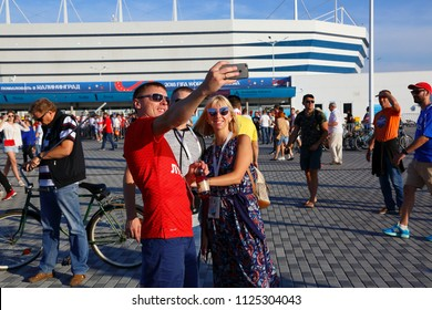 Kaliningrad, Russia 06-28-2018 : Cheerful fans before the match England Belgium. New stadium in Kaliningrad. FIFA World cup Russia 2018. kisses with girls, selfie at the stadium, sports festival. Funs