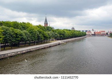 KALININGRAD, RUSSIA, 11 JUNE, 2017: view of the fishing village on the banks of the pregola river and old Gothic cathedral church