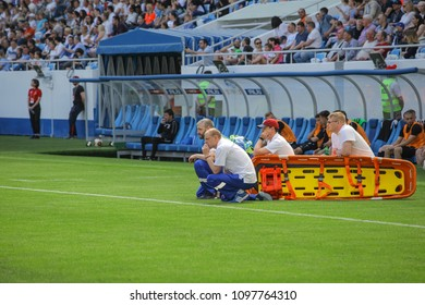KALININGRAD, RUSSIA, 12 MAY, 2018: match of the national football league of Russia between the Baltic and Tyumen. Doctors are helping out on the football field