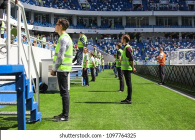 """KALININGRAD, RUSSIA, 12 MAY, 2018: service staff and security at a football match during the grand opening of the stadium """"Kaliningrad"""""""