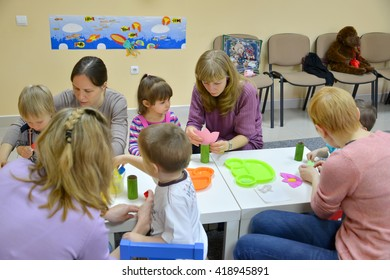 KALININGRAD, RUSSIA - APRIL 17, 2014: Children and mothers do applications in studio of creative development