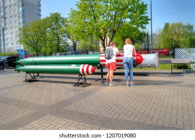 KALININGRAD, RUSSIA - April 30.2018: Exhibition buildings and exhibits on the territory of the Museum of the World Ocean. Tourists resting leaning on a torpedo