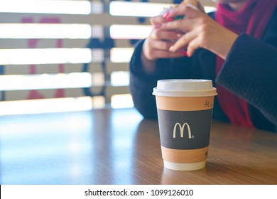 KALININGRAD, RUSSIA - CIRCA APRIL, 2018: cup of coffee on a table at McDonald's restaurant in Kaliningrad.