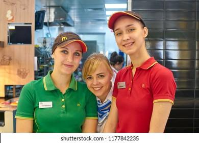 KALININGRAD, RUSSIA - CIRCA SEPTEMBER, 2018: indoor portrait of workers in McDonald's restaurant. McDonald's is an American fast food company.