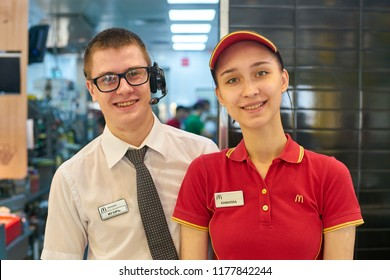 KALININGRAD, RUSSIA - CIRCA SEPTEMBER, 2018: indoor portrait of workers in McDonald's restaurant. McDonald's is an American fast food company.