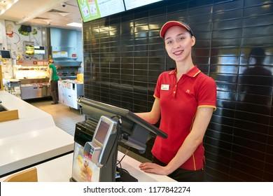 KALININGRAD, RUSSIA - CIRCA SEPTEMBER, 2018: worker in McDonald's restaurant. McDonald's is an American fast food company.