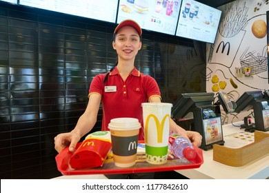 KALININGRAD, RUSSIA - CIRCA SEPTEMBER, 2018: worker with food served on a tray in McDonald's restaurant. McDonald's is an American fast food company.