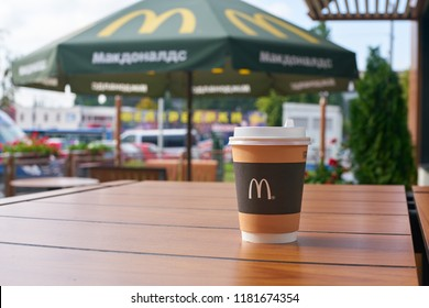 KALININGRAD, RUSSIA - CIRCA SEPTEMBER, 2018: cup with hot coffee on a table at McDonald's restaurant.
