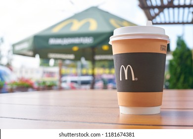 KALININGRAD, RUSSIA - CIRCA SEPTEMBER, 2018: close up shot of cup with hot coffee on a table at McDonald's restaurant.