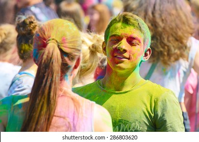 KALININGRAD, RUSSIA - JUNE 12, 2015: Unidentified young guy during Holi Festival of Colors, the event is timed to the Day of Russia.