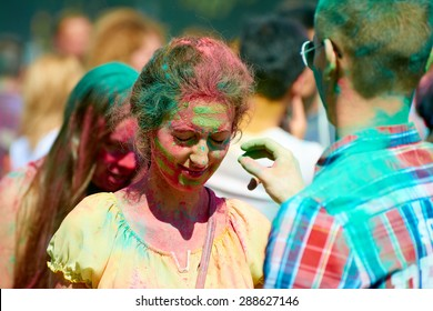 KALININGRAD, RUSSIA - JUNE 12, 2015: Unidentified girl during Holi Festival of Colors, the event is timed to the Day of Russia.