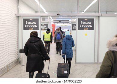 KALININGRAD, RUSSIA - MARCH 10, 2019: people come out of the airport