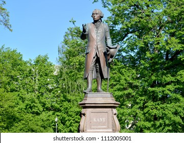 KALININGRAD, RUSSIA - MAY 05, 2018:  Monument to Immanuel Kant against the background of young foliage