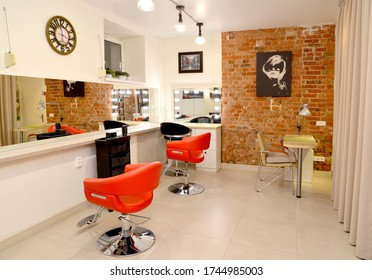 KALININGRAD, RUSSIA - MAY 19, 2020: Interior fragment of beauty salon with red chairs and manicure table