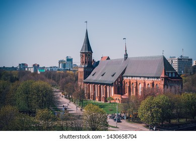 Kaliningrad, Russia - May 2019: Landscape with Cathedral, symbol of the city of Kaliningrad and the main attraction. Place for a walk in the spring day.