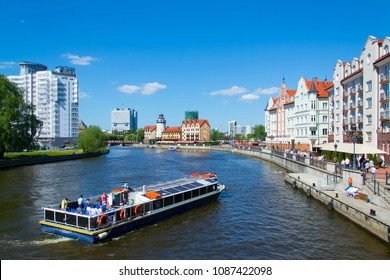 Kaliningrad, Russia - May 9, 2018: a pleasure boat with tourists is sailing along Pregel, visiting the sights of Kaliningrad