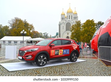 KALININGRAD, RUSSIA - OCTOBER 14, 2017: The car of Hyundai with symbolics of the FIFA World Cup of FIFA 2018 in Russia against the background of Christ the Saviour Cathedral