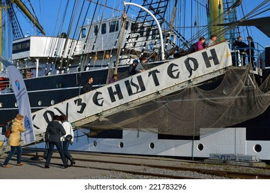 KALININGRAD, RUSSIA - OCTOBER 5, 2014: Excursion for all comers at the famous Russian tall ship Kruzenshtern ex Padua, in the Fishing port.
