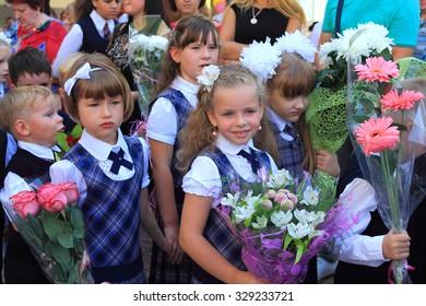 KALININGRAD, RUSSIA - SEPTEMBER 1, 2015: Girls first graders on a solemn ruler on September 1 in the city of Kaliningrad, Russia