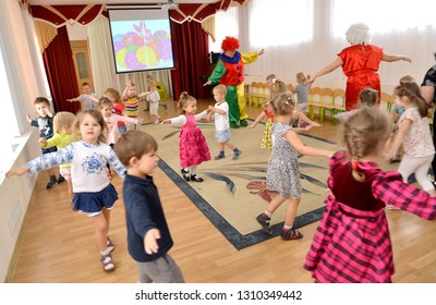 KALININGRAD, RUSSIA - SEPTEMBER 14, 2017: Small children dance together with clowns-animators. A holiday in kindergarten