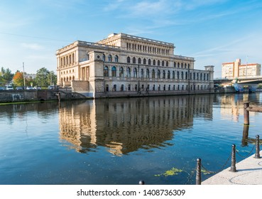 Kaliningrad, Russia - September 21, 2018: View of Kaliningrad Museum of Fine Arts with reflection in the river Pregolya. Former The Koenigsberg Stock Exchange building.
