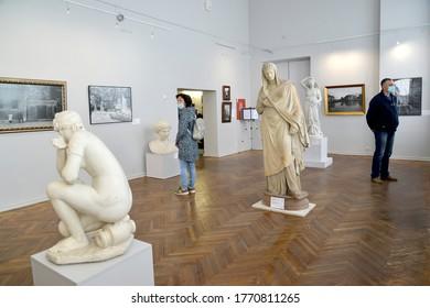 KALINNIGRAD, RUSSIA - JUNE 23, 2020: Visitors examine exhibits in medical masks in the period of COVID-19 coronavirus epidemic. Museum of Fine Arts