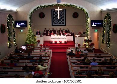 KALISPELL, MONTANA, USA - December 24, 2017: Pastor Steve Hermes preaches at a nighttime Christmas Eve service at Epworth Methodist Church.