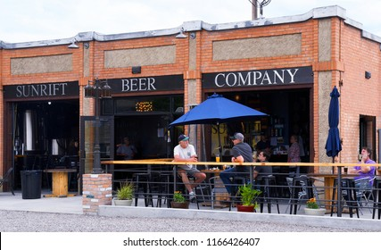KALISPELL, MONTANA, USA - June 17, 2018: Patrons drink beer outside Sunrift Beer Company microbrewery