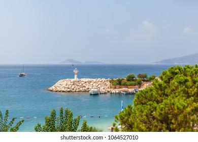 Kalkan, Kas, Turkey - August 13, 2017: View of the lighthouse in the Mediterranean sea, in the port of Kalkan
