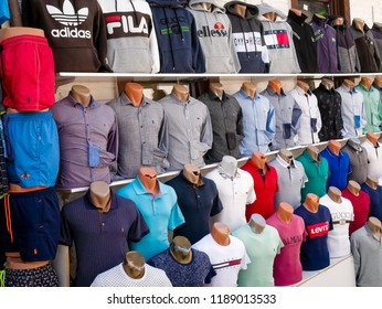 Kalkan, Turkey - July 30, 2018:Counterfeit or fake designer clothing for sale outside shop in the busy harbour area of Kalkan