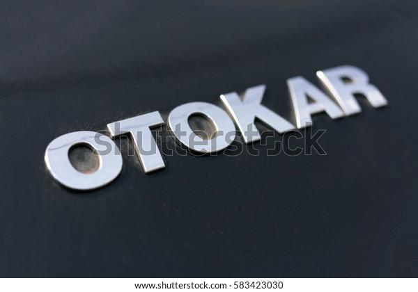 Kalkan, Turkey, May 5, 2016: Silver metal logo OTOKAR on black background