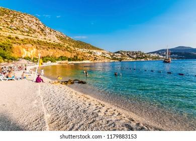 Kalkan, Turkey - September 10, 2018 :  People are resting on the beach in Kalkan Town of Turkey.