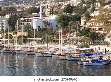 KALKAN,TURKEY-APRIL 25:Colorful Wooden excursion Boats docked at the harbor and waiting for tourists.April 25,2011 in Kalkan,Turkey.