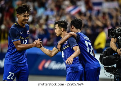 Kallang,Singapore - JUNE 13:Chanathip Songkrasin(Blue) of Thailand in action during the 28th SEA Games Singapore 2015 match between Thailand and Indonesia at Singapore National Stadium on JUNE13 2015