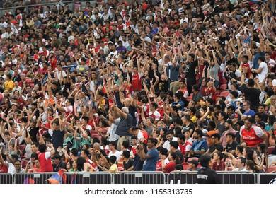 Kallang-Singapore-28Jul2018:Unidentified fans play wave during icc2018 between arsenal against at paris saint-german at national stadium,singapore