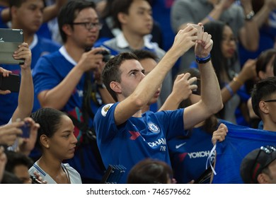 Kallang-SINGAPORE-29jul,2017:Unidentified supporter in action during icc 2017 between chelsea and FC internazionale at national stadium,singapore