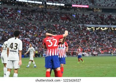 Kallang-Singapore-30Jul2018:Borja garces #32 player of Atletico madrid congratulation for goal during icc2018 between Atletico madrid against paris saint-german at national stadium,singapore